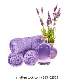 spa concept - towels and lavender flowers and stones isolated on white background isolated on white background