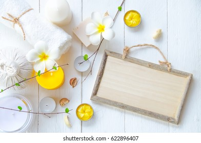 spa concept in yellow color with white wooden background.
