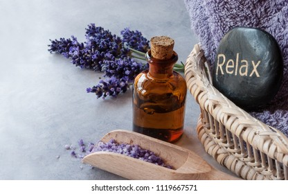 SPA, essential oil with lavender flowers - health and beauty, stone spa