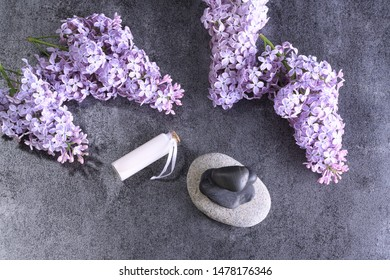 spa, essential oil and lilac flowers