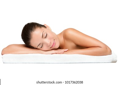 Spa. Face skincare beauty woman smiling happy. Beautiful attractive mixed race Chinese Asian / Caucasian female model lying down on towel during skin care treatment isolated on white background.