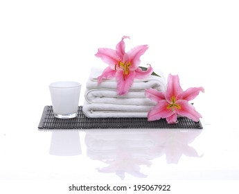 Spa feeling with two lily ,towel on mat