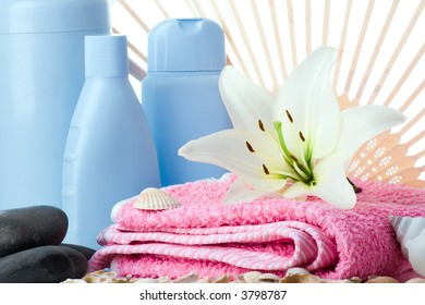 spa flower stone towel fun bottle on white