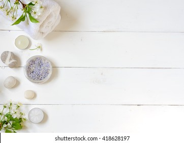 Spa, flowers, towel on a wooden background.Top view