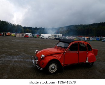 Spa Francorchamps - 11-16-2011 Wallonia, Belgium. A red Citroen 2cv is parking near the racetrack on a rainy day