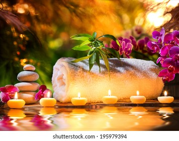 spa in garden - candles and water