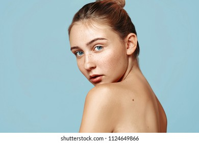 Spa girl with freckles beautiful portrait, Young female fresh healthy skin, skincare and cosmetology concept, rejuvenation and treatment