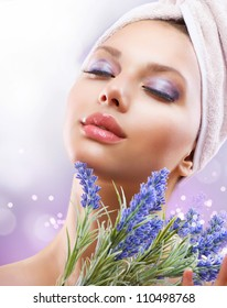 Spa Girl with Lavender Flowers.Organic Cosmetics. Beautiful Young Woman After Bath. Perfect Skin. Skincare. Young Skin