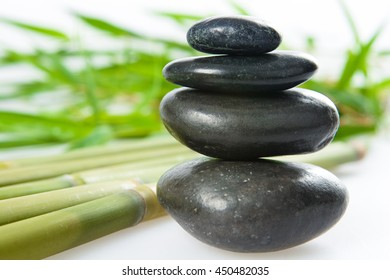 spa la stone health therapy pebbles stack isolated on white with bamboo