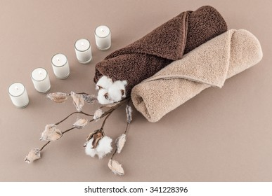 Spa Luxury Towels, Cotton Branch, and Lit Candles