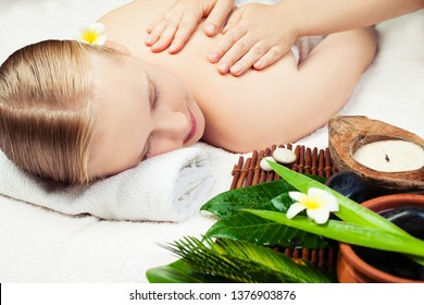 Spa massage with aromathrepy. Beautiful young woman getting spa massage. Spa concept