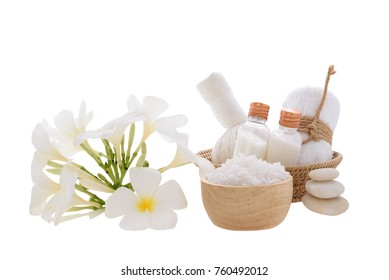 Spa and massage ball with essential oils,zen stone, towels and frangipani flowers on wooden tray isolated over white background with clipping path