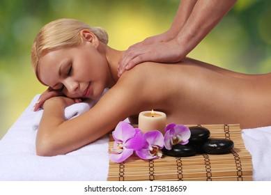 Spa Massage. Beautiful Blonde Woman Getting Body Massage. Outdoor. Beauty Treatments.