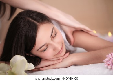 Spa Massage. Beautiful Brunette Gets Spa Treatment in Salon.