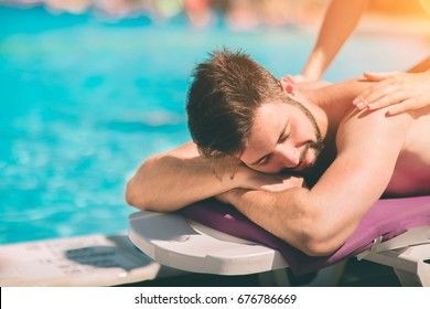 Spa Massage. Beautiful Happy Smiling Woman Enjoying Relaxing Body Massage Treatment Outdoors At Beauty Salon. People At Romantic Day Spa Resort. Health Care And Relax Concept