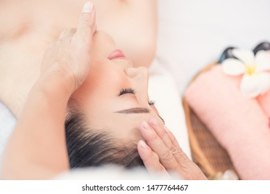 Spa and massage concept, Close up  of Asian woman  Relaxing for facial and head massage spa treatment