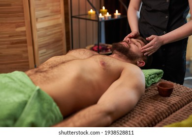 Spa Massage. Hands Massaging Man Head And Neck At Thai Beauty Salon