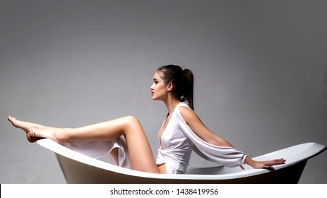 Spa and massage. makeup and hair style. trendy look. Sensual woman. Beauty and fashion. Sexy girl. sexy woman sit on bathtub. bathroom interior. hygiene and self care. epilation and shaving legs.