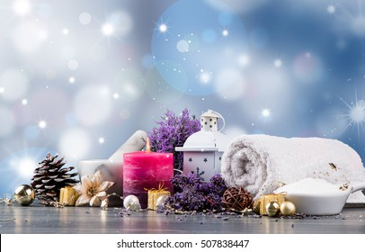 spa massage setting, lavender product, oil and christmas decoration on wooden background, Christmas wellness concept