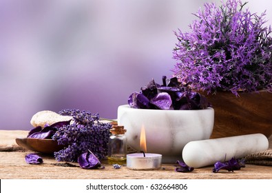Spa massage setting, lavender product, oil on wooden background