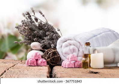 spa massage setting, nature product, oil on wooden background