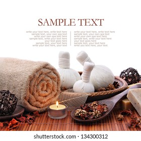 Spa massage setting with rolled, towel, compress balls and candlelight