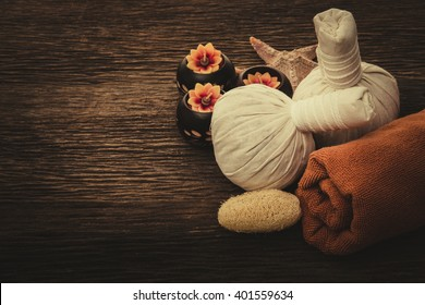 Spa Massage , setting with rolled, towel, candlelight