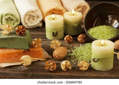 Spa massage setting with rolls  towels,  natural soap and candlelight