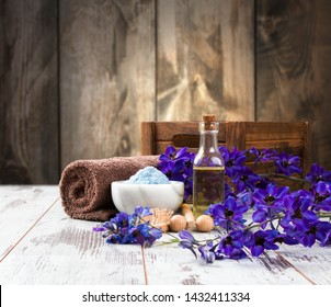 spa massage setting,product, oil on wooden background