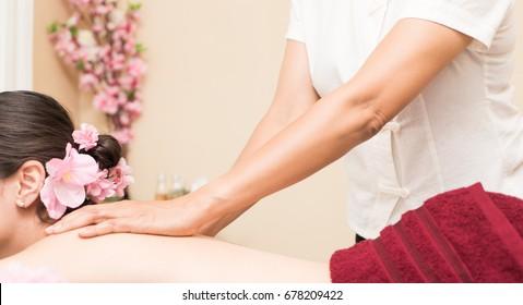 Spa Massage Therapist is scrubbing women back