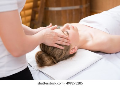 Spa. Masseuse put her hands on girl's face