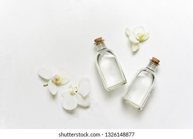 Spa natural cosmetic concept, face or body lotion bottled, flat lay composition