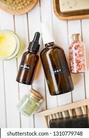 Spa natural products with rose water and argan oil bottles, bath salt, natural soap, natural organic skincare and beauty products top view