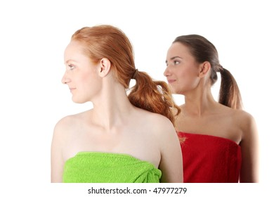 Spa - portrait of two woman - redhead and brunette - isolated on white background
