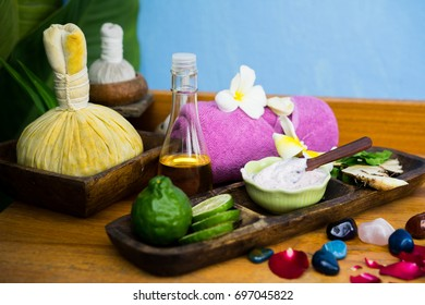Spa products and equipment On a wooden table with a blue background.Select White and soft focus.