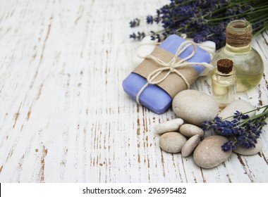 Spa products and lavender flowers on a old wooden background