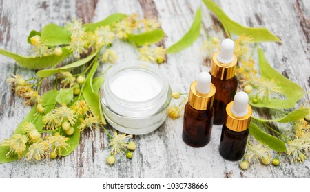 Spa products with linden flowers on a table