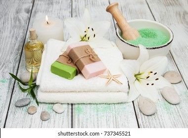 Spa products with white lily on a old wooden background
