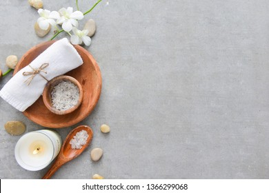 Spa products in wooden tray in round shape-gray background
