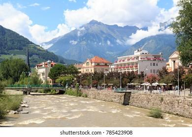 Spa promenade, river Passer and mountain alps panorama in Merano, South Tyrol