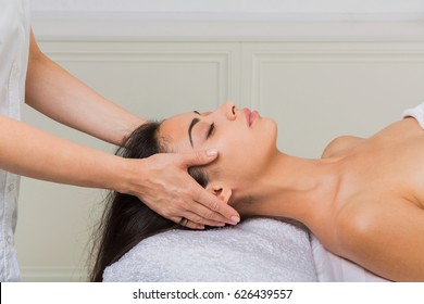 Spa relax. Face lifting massage to beautiful girl in cosmetology cabinet or beauty parlor.