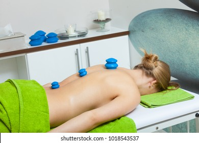 Spa relaxation, healthy pleasure, beauty concept. Woman lying on stomach, getting spa therapy cupping glass vacuum massage in salon. Alternative medicine procedure, body care.