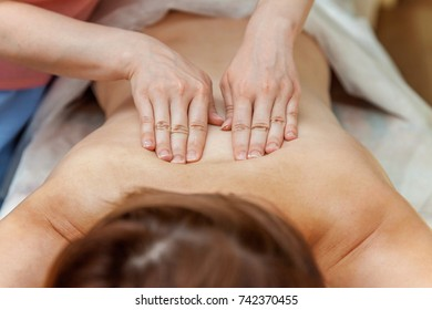 spa, resort, beauty and health concept - beautiful woman in spa salon having massage