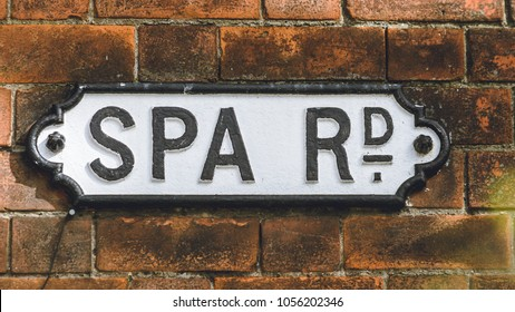 Spa Road Vintage Street Name Sign on Brick Wall, Shallow Depth of Field horizontal photography