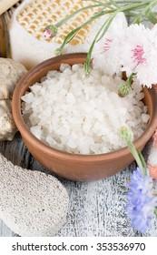 Spa salon with sea salt and flowers