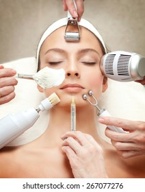 Spa Salon: Young Beautiful Woman Having Different Facial Treatment