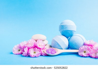 Spa salt, stones and bath bomb, flower branch for beauty and health. Healthy relaxation, therapy and treatment. Aromatherapy, body care, aroma massage. Alternative lifestyle.