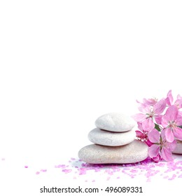 Spa salt and stones, flower branch for beauty and health. Healthy relaxation, therapy and treatment. Aromatherapy, body care, aroma massage. Alternative lifestyle. Relax in bath.