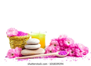 Spa salt and stones, towel, candle, flower branch for beauty and health. Healthy relaxation, therapy and treatment. Aromatherapy, body care, aroma massage. Alternative lifestyle
