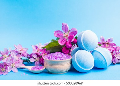 Spa salt, towel flower branch, bath bomb for beauty and health. Healthy relaxation, therapy and treatment. Aromatherapy, body care, aroma massage. Alternative lifestyle. Relax in bath.
